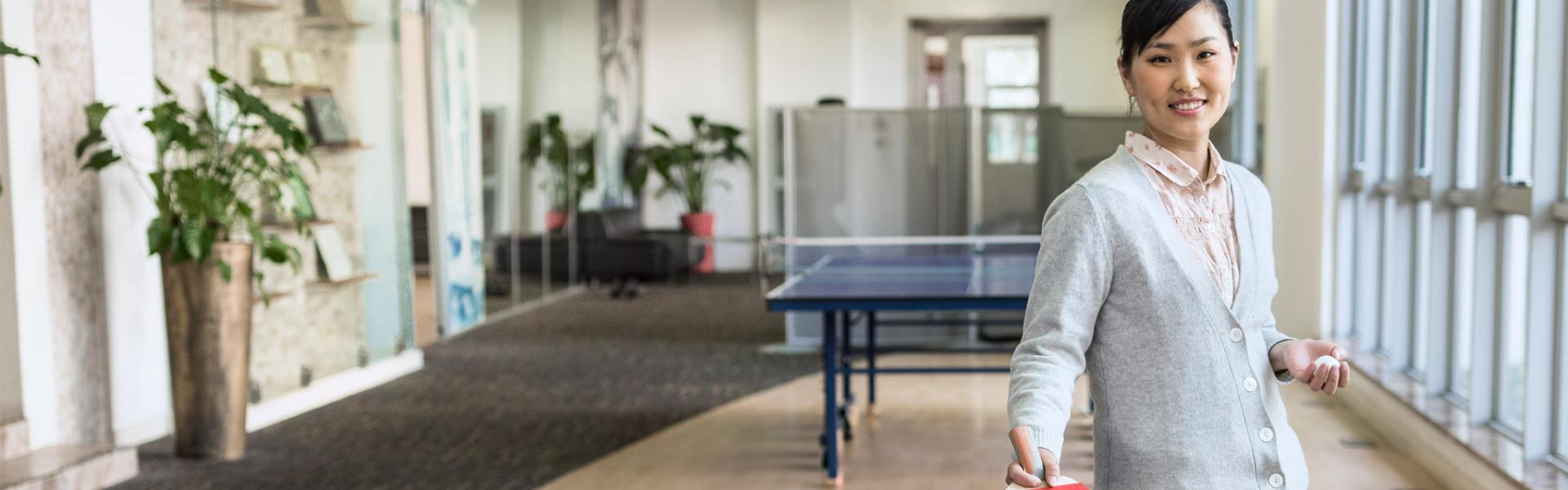 SAP employee Bella at a ping-pong table
