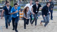 Students running at a SAP student event