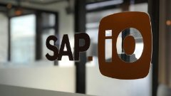 SAP.iO logo on a glass wall